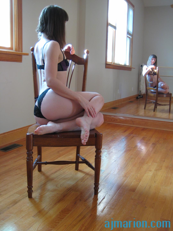 Bra pantie set on wooden chair in studio, nat light